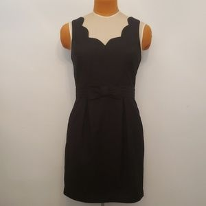 Black scalloped sheath dress